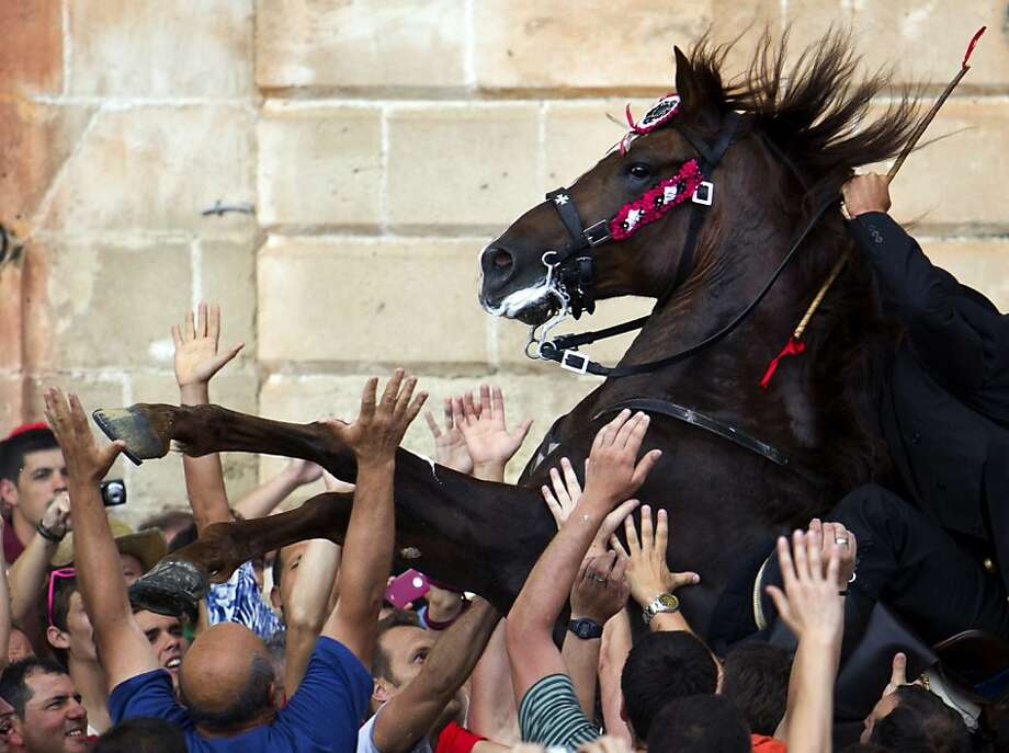 A horse rears in a crowdduring the traditional San Juan festival in the town of Ciutadella, Menorca, on the eve of Saint John's day. Photo: Jaime Reina, AFP/Getty Images
