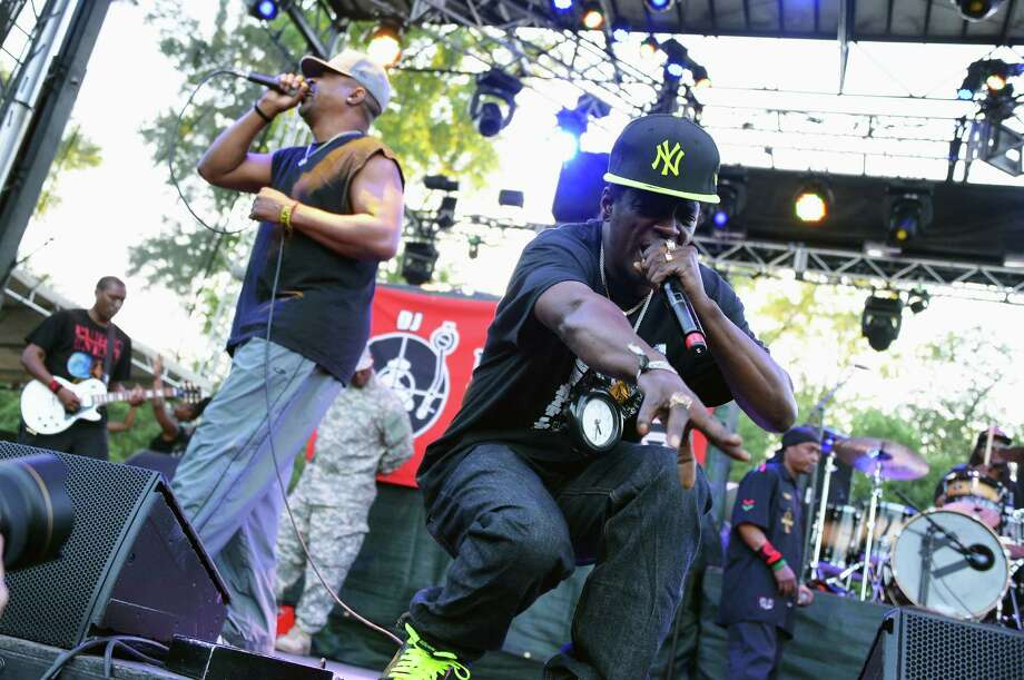 Chuck D (L) and Flavor Flav of Public Enemy perform onstage at the Firefly Music Festival at The Woodlands of Dover International Speedway on June 21, 2013 in Dover, Delaware. Photo: Theo Wargo, (Credit Too Long, See Caption) / 2013 Getty Images