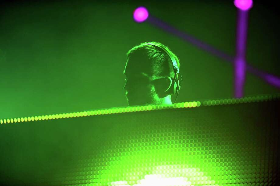 Calvin Harris spins onstage at the Firefly Music Festival at The Woodlands of Dover International Speedway on June 21, 2013 in Dover, Delaware.  Photo: Theo Wargo, (Credit Too Long, See Caption) / 2013 Getty Images