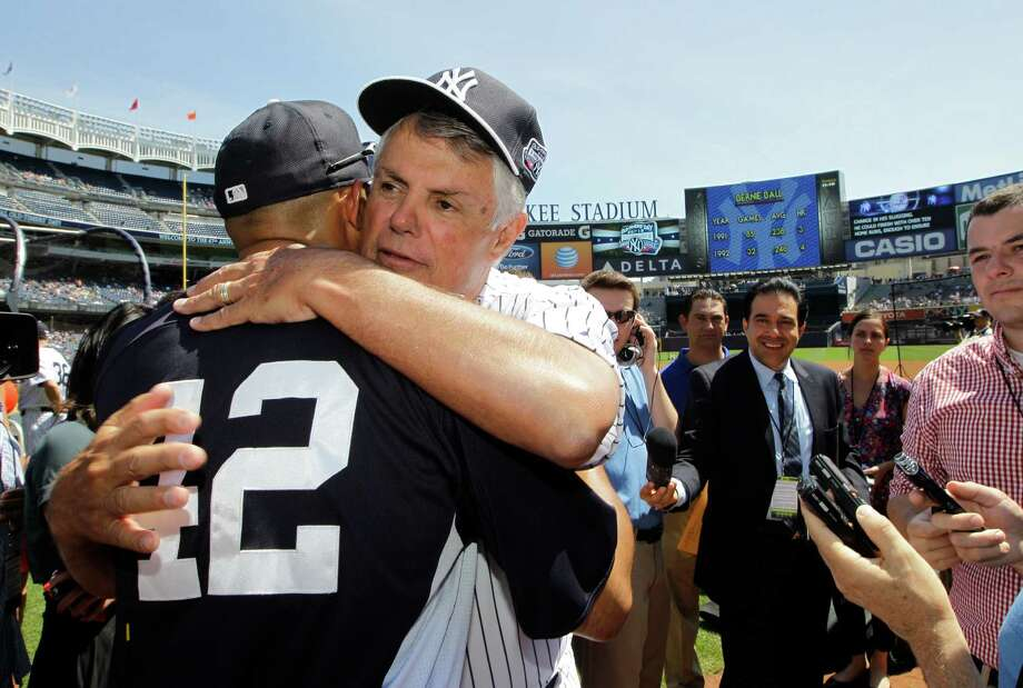 Former New York Yankees manager Lou Piniella, second from left, embraces Yankees relief pitcher Mariano Rivera (42) before the Old Timers Day baseball game on Sunday, June 23, 2013, in New York. (AP Photo/Kathy Willens) Photo: Kathy Willens