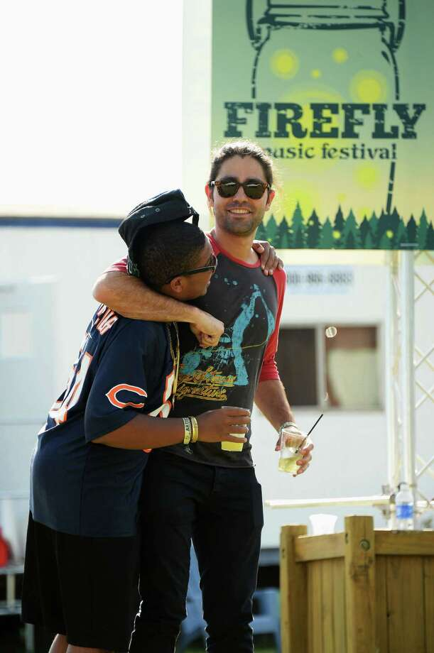 Reef Mckeithan (L) and Adrian Grenier hang out at the Artist Compound at the Firefly Music Festival at The Woodlands of Dover International Speedway on June 22, 2013 in Dover, Delaware.  Photo: Theo Wargo, (Credit Too Long, See Caption) / 2013 Getty Images
