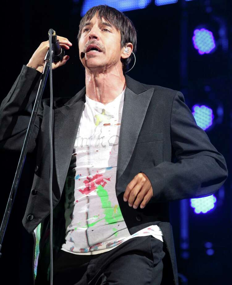 Anthony Kiedis of the Red Hot Chili Peppers performs on Day 1 of the Firefly Music Festival at The Woodlands on Friday, June 21, 2013 in Dover, Del. Photo: Owen Sweeney, Associated Press / Invision