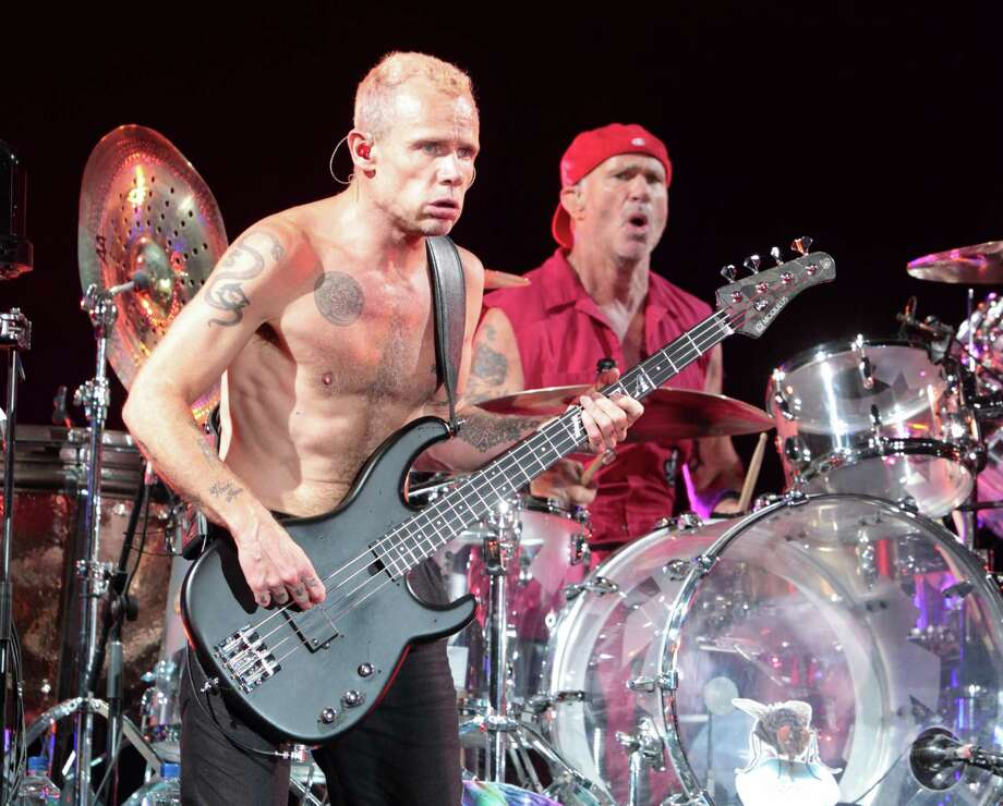 Flea and Chad Smith of the Red Hot Chili Peppers performs on Day 1 of the Firefly Music Festival at The Woodlands on Friday, June 21, 2013 in Dover, Del.  Photo: Owen Sweeney, Associated Press / Invision