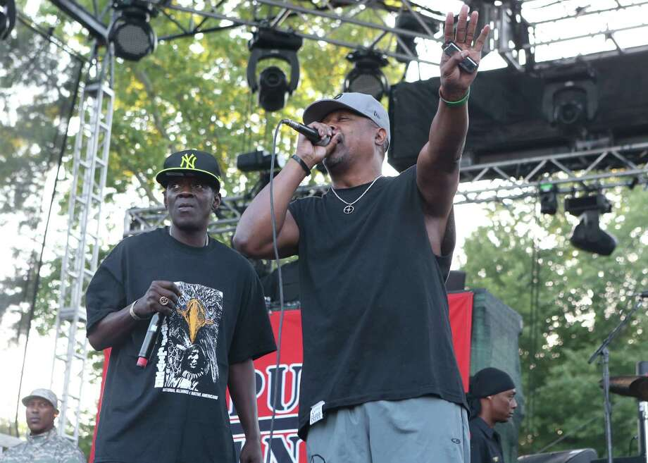 Flavor Flav and Chuck D of the rap group Public Enemy perform on Day 1 of the Firefly Music Festival at The Woodlands on Friday, June 21, 2013 in Dover, Del. Photo: Owen Sweeney, Associated Press / Invision