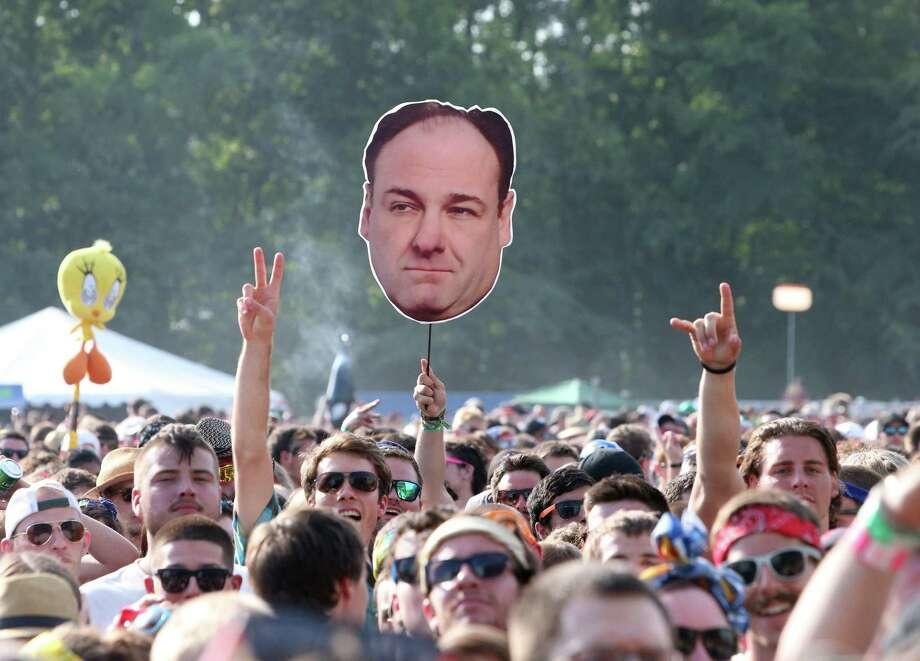 Concert goers display a photo of actor James Gandolfini during Day 2 of the Firefly Music Festival at The Woodlands on Saturday, June 22, 2013 in Dover, Del. Photo: Owen Sweeney, Associated Press / Invision