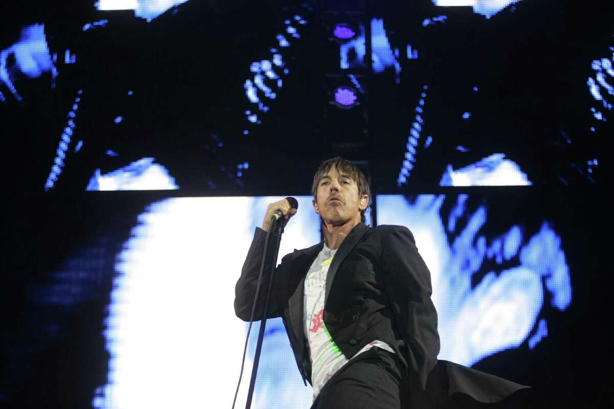 Anthony Kiedis of The Red Hot Chili Peppers performs on the Firefly Stage on day one of the Firefly Music Festival Friday June 21, 2013, in Dover, Del. (AP Photo/The Wilmington News-Journal, Suchat Pederson) NO SALES