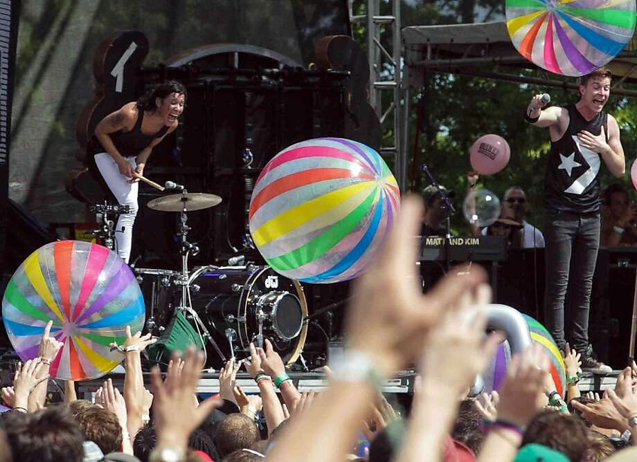 Fans cheer as Matt and Kim perform during the Firefly Music Festival on Sunday June 23, 2013, in Dover, Del. (AP Photo/The Wilmington News-Journal, Suchat Pederson) Photo: Suchat Pederson, Associated Press
