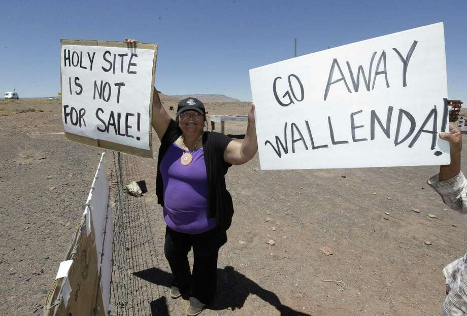 Renae Yellowhorse, a Navajo from Cameron,  gathers with others American Indians along highway, near Cameron, Ariz., on Sunday, June 23, 2013 to protest Florida aerialist Nik Wallenda's tightrope walk over the Little Colorado River Gorge. Wallenda planned the stunt without a safety harness on the Navajo reservation. (AP Photo/Rick Bowmer) Photo: Rick Bowmer