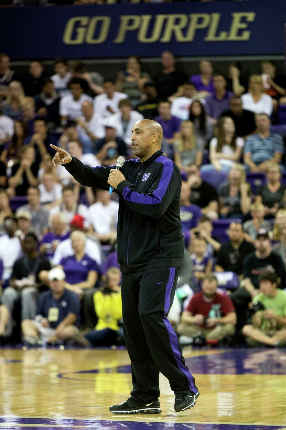 UW men's basketball head coach Lorenzo Romar addresses the audience during the University of Washington Alumni Game Sunday, June 23, 2013, in the Alaska Airlines Arena at the University of Washington in Seattle. The after-2009 team, in purple, beat the pre-2009 team, in white, 107-104.