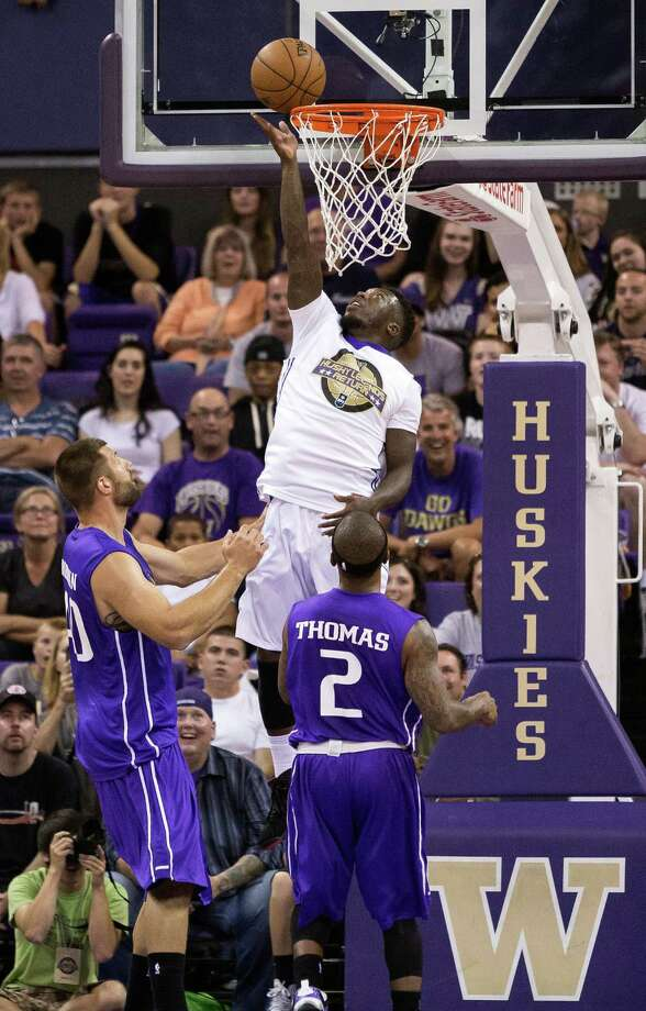 Nate Robinson, top, touches in a layup during the University of Washington Alumni Game Sunday, June 23, 2013, in the Alaska Airlines Arena at the University of Washington in Seattle, Wash. The after-2009 team, in purple, beat the pre-2009 team, in white, 107-104. Photo: JORDAN STEAD, SEATTLEPI.COM / SEATTLEPI.COM