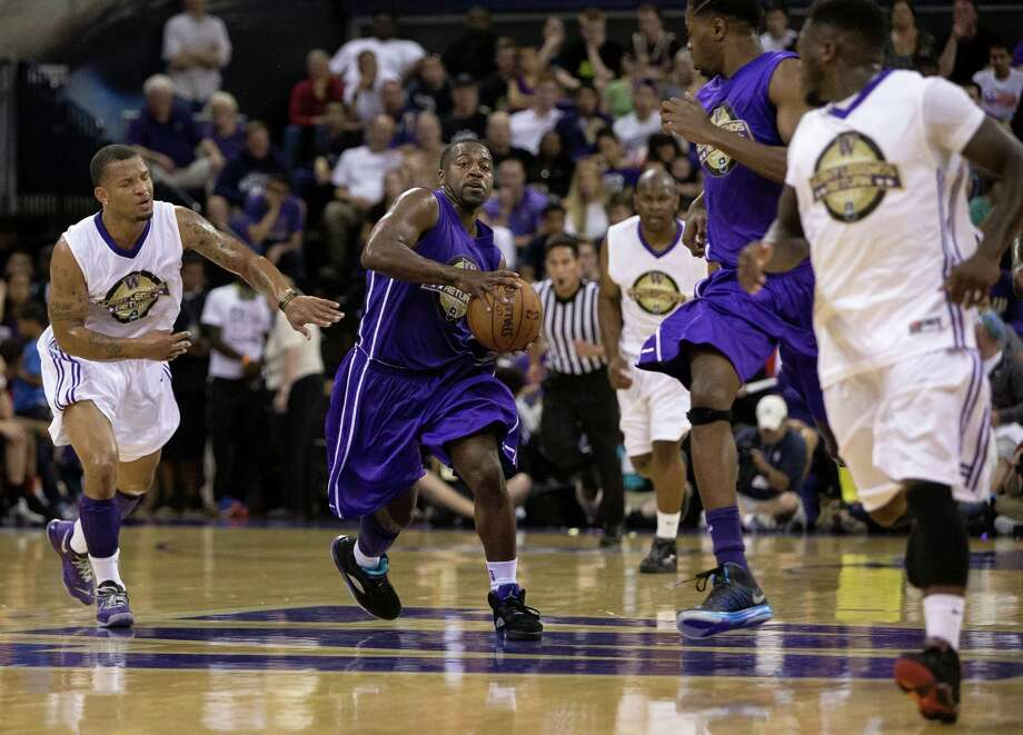 Tony Wroten, center, dribbles down court during the University of Washington Alumni Game Sunday, June 23, 2013, in the Alaska Airlines Arena at the University of Washington in Seattle, Wash. The after-2009 team, in purple, beat the pre-2009 team, in white, 107-104. Photo: JORDAN STEAD, SEATTLEPI.COM / SEATTLEPI.COM