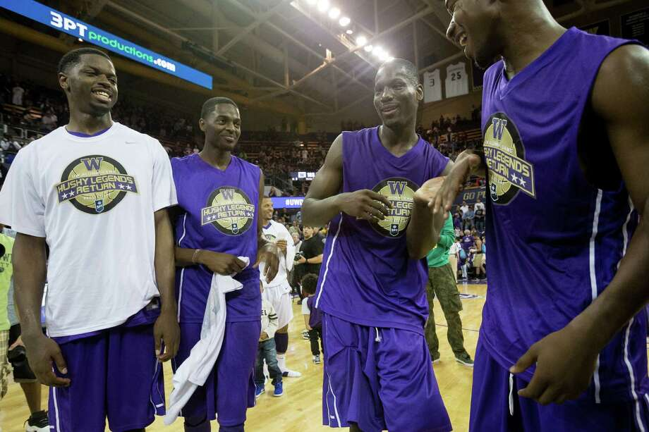 Darnell Gant, center left, prepares to accept a trophy following his victory in the slam dunk contest at the University of Washington Alumni Game Sunday, June 23, 2013, in the Alaska Airlines Arena at the University of Washington in Seattle, Wash. The after-2009 team, in purple, beat the pre-2009 team, in white, 107-104. Photo: JORDAN STEAD, SEATTLEPI.COM / SEATTLEPI.COM