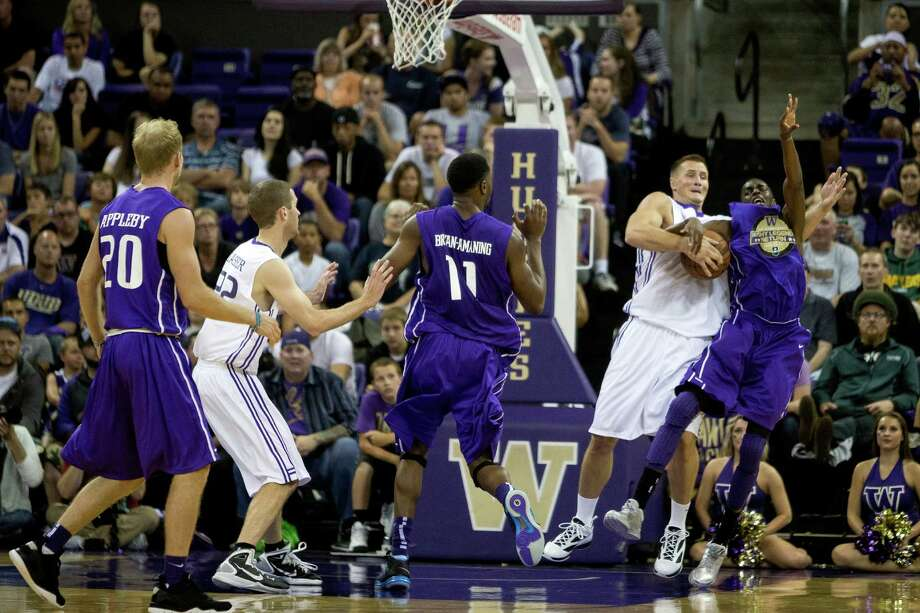 University of Washington basketball players reunited for an afternoon of fun and hoops in front of a crowd of thousands at the Alumni Game Sunday, June 23, 2013, in the Alaska Airlines Arena at the University of Washington in Seattle. The after-2009 team, in purple, beat the pre-2009 team, in white, 107-104. Photo: JORDAN STEAD, SEATTLEPI.COM / SEATTLEPI.COM