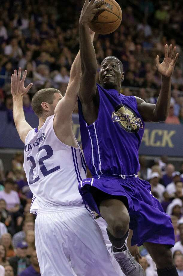 Darnell Gant, right, goes up for a layup past the competition during the University of Washington Alumni Game Sunday, June 23, 2013, in the Alaska Airlines Arena at the University of Washington in Seattle, Wash. The after-2009 team, in purple, beat the pre-2009 team, in white, 107-104. Photo: JORDAN STEAD, SEATTLEPI.COM / SEATTLEPI.COM