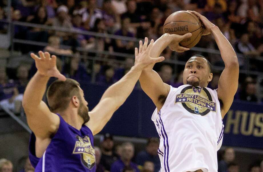 Brandon Roy, right, takes a jump shot over the competition during the University of Washington Alumni Game Sunday, June 23, 2013, in the Alaska Airlines Arena at the University of Washington in Seattle, Wash. The after-2009 team, in purple, beat the pre-2009 team, in white, 107-104. Photo: JORDAN STEAD, SEATTLEPI.COM / SEATTLEPI.COM