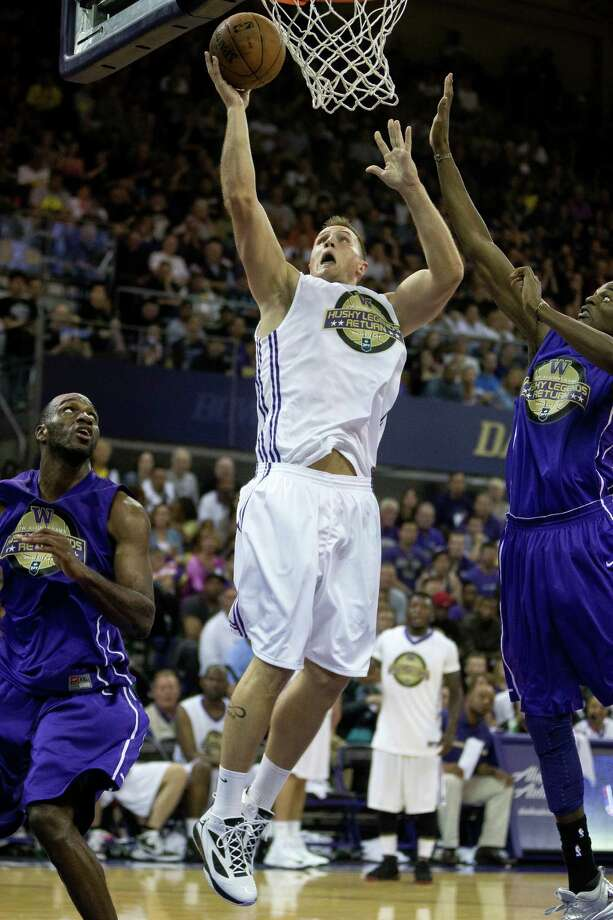 Mike Jensen goes for a layup at the University of Washington Alumni Game Sunday, June 23, 2013, in the Alaska Airlines Arena at the University of Washington in Seattle. The after-2009 team, in purple, beat the pre-2009 team, in white, 107-104. Photo: JORDAN STEAD, SEATTLEPI.COM / SEATTLEPI.COM