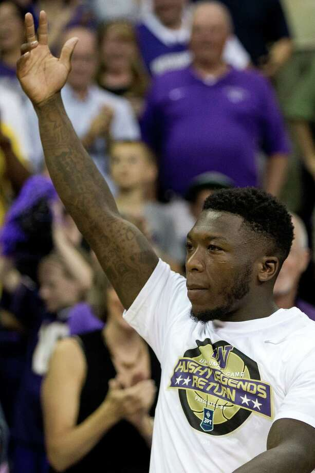 Nate Robinson enters the arena at the beginning of the University of Washington Alumni Game Sunday, June 23, 2013, in the Alaska Airlines Arena at the University of Washington in Seattle, Wash. The after-2009 team, in purple, beat the pre-2009 team, in white, 107-104. Photo: JORDAN STEAD, SEATTLEPI.COM / SEATTLEPI.COM