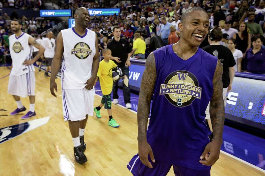 Isaiah Thomas laughs with teammates after a victory in his favor following the University of Washington Alumni Game Sunday, June 23, 2013, in the Alaska Airlines Arena at the University of Washington in Seattle, Wash. The after-2009 team, in purple, beat the pre-2009 team, in white, 107-104. Photo: JORDAN STEAD, SEATTLEPI.COM / SEATTLEPI.COM