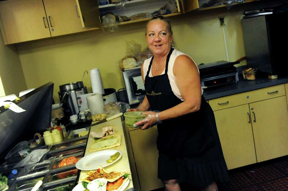 Cindy Leffler makes lunch for Excelsior College employees on Wednesday, June 19, 2013, at Corporate Sandwich in Albany, N.Y. Leffler commutes every day from Petersburgh to run her restaurant business in the basement of Excelsior College. She's among the 70,0000 people who come to Albany every day to work. (Cindy Schultz / Times Union) Photo: Cindy Schultz / 10022874A
