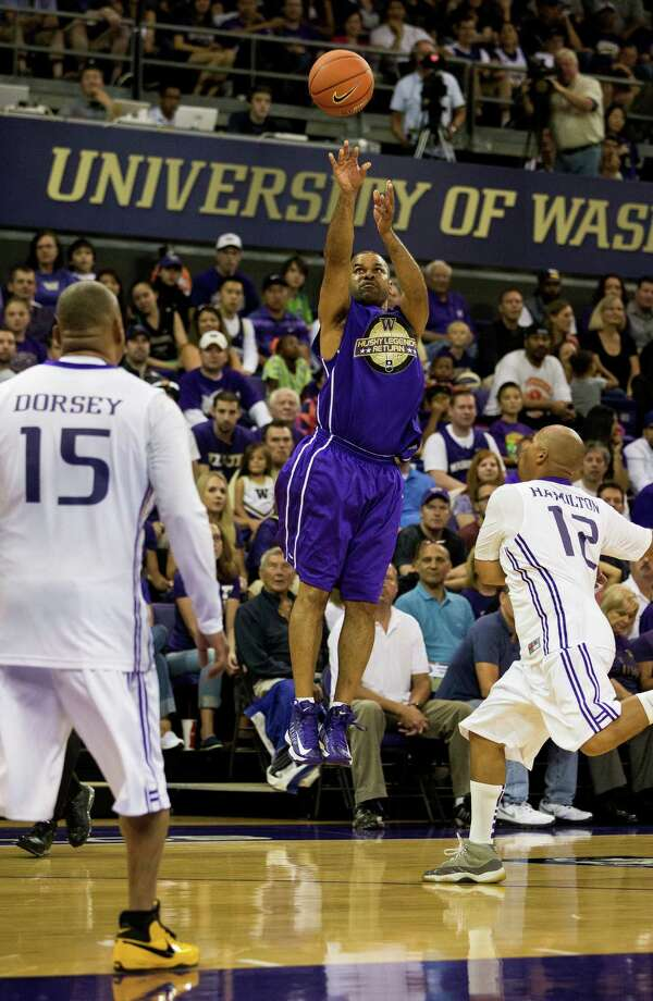 Basketball players and friends alike reunited for an afternoon of fun and hoops in front of a crowd of thousands for the Husky Legends Return game at a University of Washington Men's Basketball Alumni Event Sunday, June 23, 2013, in the Alaska Airlines Arena at the University of Washington in Seattle. In addition to the Legends Game, the day's events also included an Alumni Game 3-point shootout and slam-dunk contest. The event was presented and produced by 3 Point Productions. Photo: JORDAN STEAD, SEATTLEPI.COM / SEATTLEPI.COM