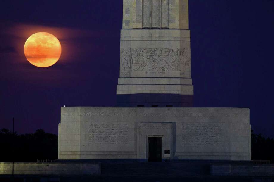 The supermoon rises behind the San JacintoMonument on Sunday, June 23, 2013, in La Porte. The larger than normal moon called the supermoon happens only once this year as the moon on its elliptical orbit is at its closest point to the earth and is 13.5 percent larger than usual. Photo: J. Patric Schneider, For The Chronicle / © 2013 Houston Chronicle