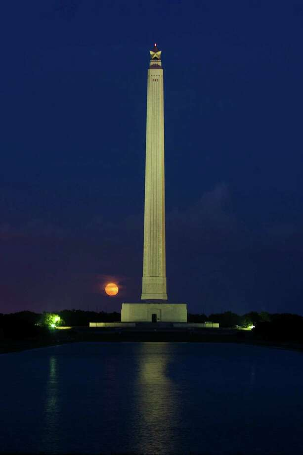 The supermoon rises behind the San Jacinto Monument on Sunday, June 23, 2013, in La Porte. The larger than normal moon called the supermoon happens only once this year as the moon on its elliptical orbit is at its closest point to the earth and is 13.5 percent larger than usual. Photo: J. Patric Schneider, For The Chronicle / © 2013 Houston Chronicle