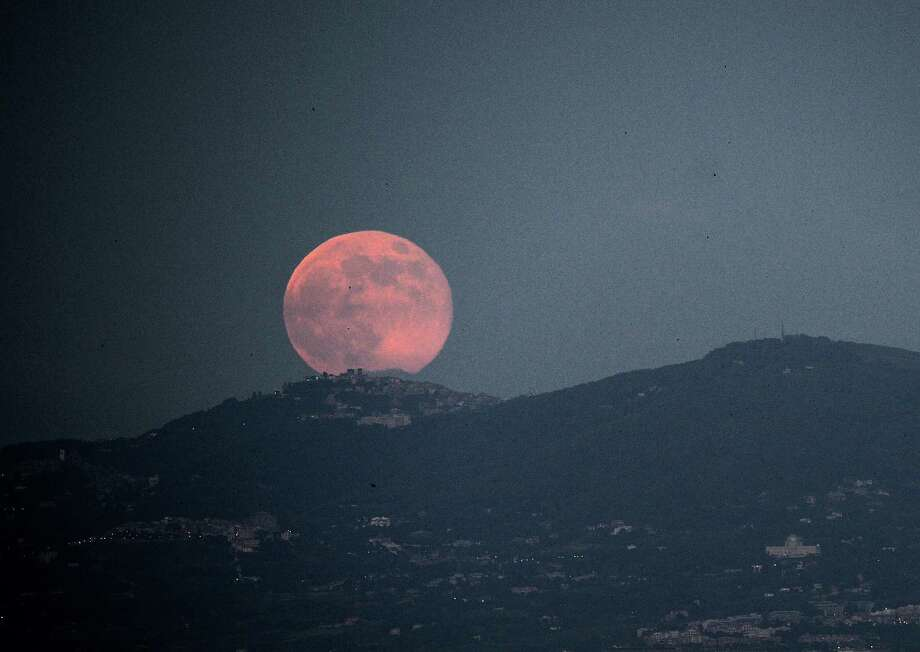A rising moon is seen over the city of Rome on June 23, 2013. The full moon at perigee on called a 'supermoon' is the largest and closest full moon of the year as it appears 14 percent larger and 30 per cent brighter than normal. Photo: FILIPPO MONTEFORTE, AFP/Getty Images / AFP