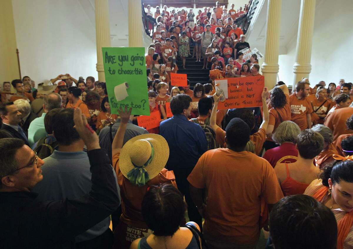 """A crowd gathers at the state Capitol, many wearing T-shirts with the words """"Stand with Texas Women,"""" to protest Republican efforts to pass a bill to impose tighter restrictions on abortion."""