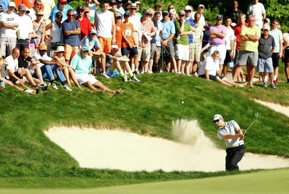 CROMWELL, CT- JUNE 23: Chris Stroud hits a shot from the bunker on the 15th hole during the final round of the 2013 Travelers Championship at TPC River Highlands on June 23, 2012 in Cromwell, Connecticut.  (Photo by Jared Wickerham/Getty Images) Photo: Jared Wickerham, Staff / 2013 Getty Images
