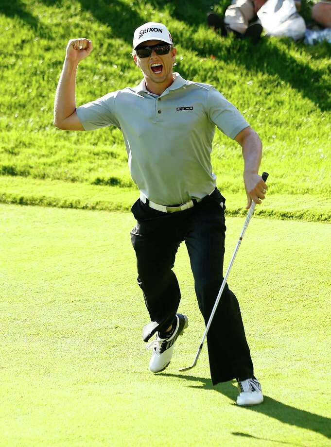 CROMWELL, CT- JUNE 23: Chris Stroud celebrates after chipping in a birdie on the 18th hole to force a playoff against Ken Duke during the final round of the 2013 Travelers Championship at TPC River Highlands on June 23, 2012 in Cromwell, Connecticut.  (Photo by Jared Wickerham/Getty Images) Photo: Jared Wickerham, Staff / 2013 Getty Images