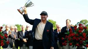 CROMWELL, CT- JUNE 23: Ken Duke holds up the Traveler's Championship trophy after winning in a second playoff against Chris Stroud during the final round of the 2013 Travelers Championship at TPC River Highlands on June 23, 2012 in Cromwell, Connecticut.  (Photo by Jared Wickerham/Getty Images)