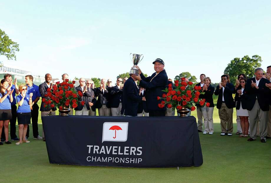CROMWELL, CT- JUNE 23: Ken Duke holds up the Traveler's Championship trophy after winning in a second playoff against Chris Stroud during the final round of the 2013 Travelers Championship at TPC River Highlands on June 23, 2012 in Cromwell, Connecticut.  (Photo by Jared Wickerham/Getty Images) Photo: Jared Wickerham, Staff / 2013 Getty Images