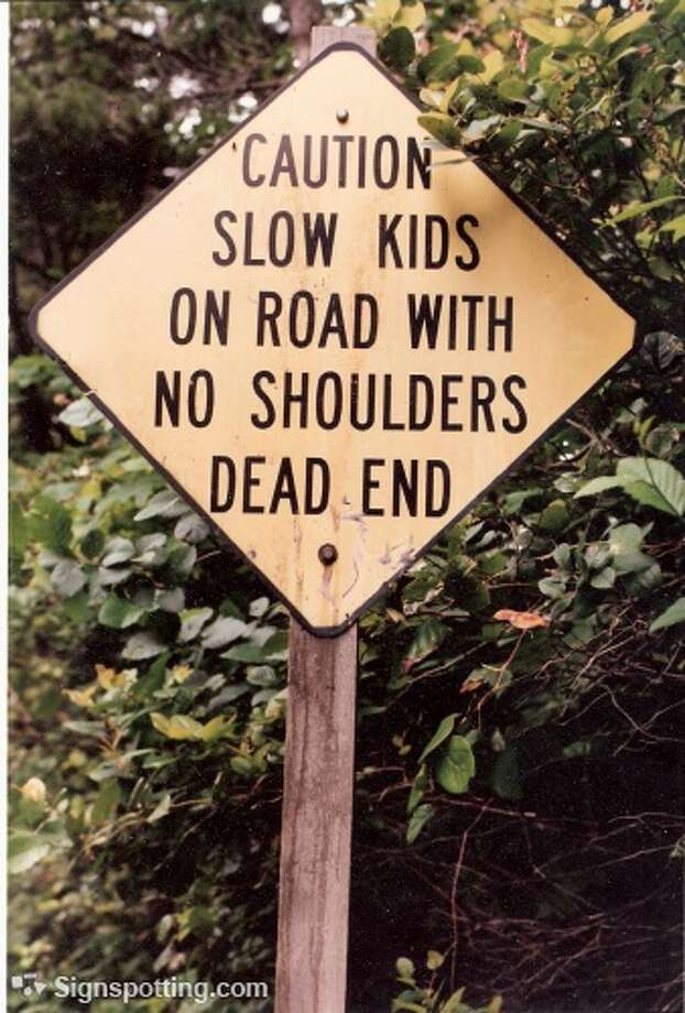 Beware the slow-moving, shoulder-less children. Cairn, Australia.