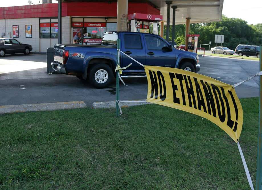 This photo taken June 20, 2013, shows a sign advertising no ethanol gasoline available at a station in Oklahoma City. A high blend of ethanol gasoline, E15, which contains 5 percent more ethanol than the 10 percent norm sold at most U.S. gas stations, is sold in just 20 stations in six Midwestern states. Sales could spread as the Obama administration considers whether to require more ethanol in gasoline; it's cheaper and cleaner but it could damage older cars and motorcycles. And American Petroleum Institute, the oil industry's powerful lobbying group, has asked the Supreme Court to block it's sale. The Court may decide as soon as Monday, June 24, 2013, whether to hear the case. Photo: Sue Ogrocki