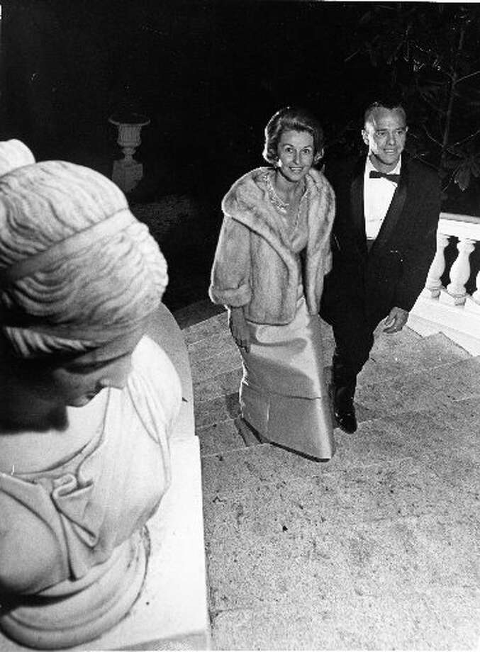 Astronaut Alan Shepard and his wife, Louise, attend a black-tie party hosted by Joanne King and Mrs. Milton Berman, in Houston, Nov. 1965. (Darrell Davidson)