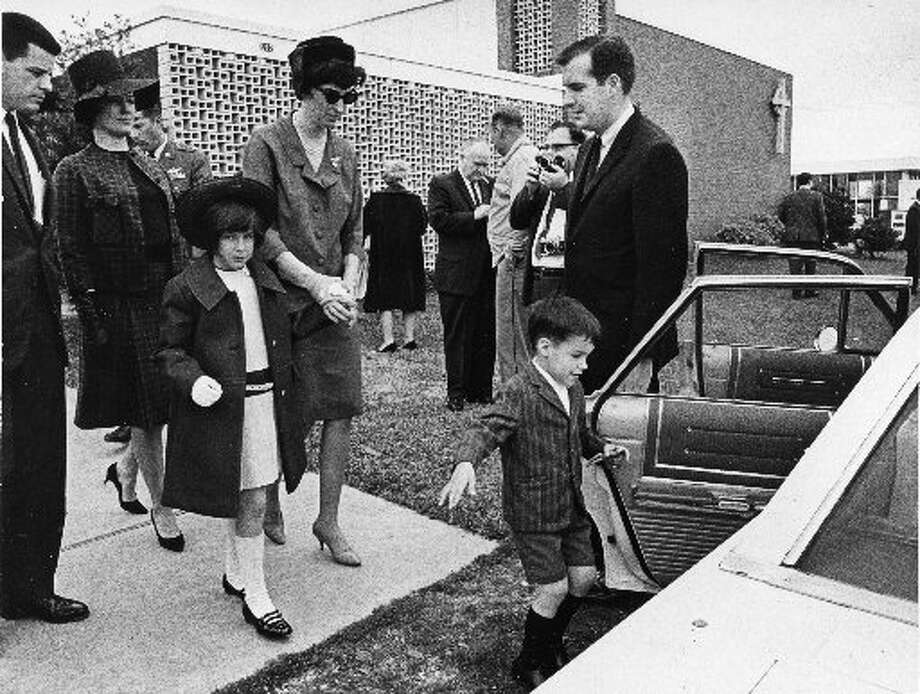 Jean Bassett, widow of astronaut Charles A. Bassett II, holds the hand of her daughter, Karen, as they leave Webster Presbyterian Church following the memorial services for astronaut Bassett, on March 2, 1966. Son Peter is about to step into the waiting car. Bassett and fellow astronaut Elliott See Jr. died in a plane crash in St. Louis, Feb. 28, 1966 before their first mission. (Houston Chronicle)