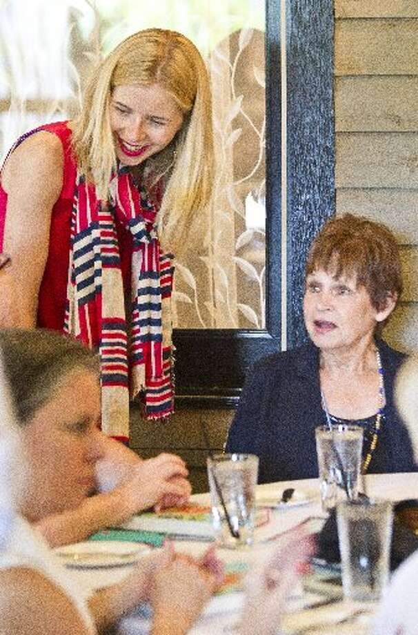 """Lily Koppel, author of """"The Astronaut Wives Club,"""" visits with Harriet Eisele, ex-wife of the late Donn Eisele, during a tea and book party for Koppel's new book at Ouisie's Table in Houston, June 19, 2013. ( Nick de la Torre / Houston Chronicle )"""
