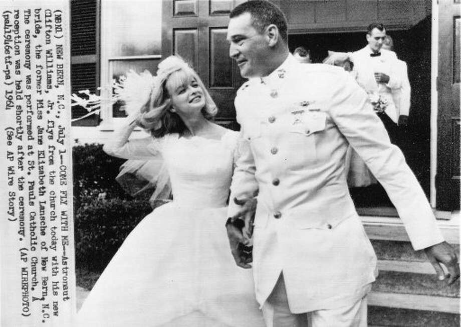 Astronaut Clifton Williams, Jr. flies from the church today with his new bride, the former Jane Elizabeth Lansche, in New Bern, NC. The ceremony was performed at St. Paul's Catholic Church. A reception was held shortly after the ceremony. (AP)