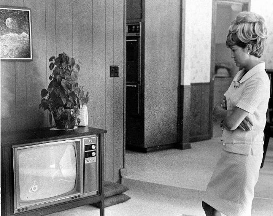 Barbara Cernan follows the Gemini IX mission of her husband, Eugene Cernan, and astronaut Thomas Stafford on television, June 1966. (Houston Chronicle files)