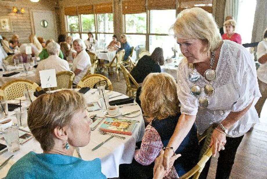 "Barbara Cernan Butler introduces herself during a tea and book party for Lily Koppel's book, ""The Astronaut Wives Club,"" June 19, 2013, at Ouisie's Table in Houston. Cernan is the former wife of astronaut Eugene Cernan. ( Nick de la Torre / Houston Chronicle )"