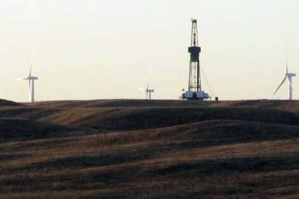 """A rig drilling an oil well for QEP Resources Inc., is shown on ranchland a few miles west of Cheyenne, Wyo., Thursday Sept. 30, 2010. More oil rigs are popping up around Cheyenne and some new wells 50 miles north of town might already be producing oil from the Niobrara Shale. The Wyoming Oil and Gas Conservation Commission has issued permits for more than 50 oil wells in northern Laramie County and southern Goshen and Platte counties so far this year. Dozens of those wells are now marked """"confidential"""" on the production information page on the commission website."""