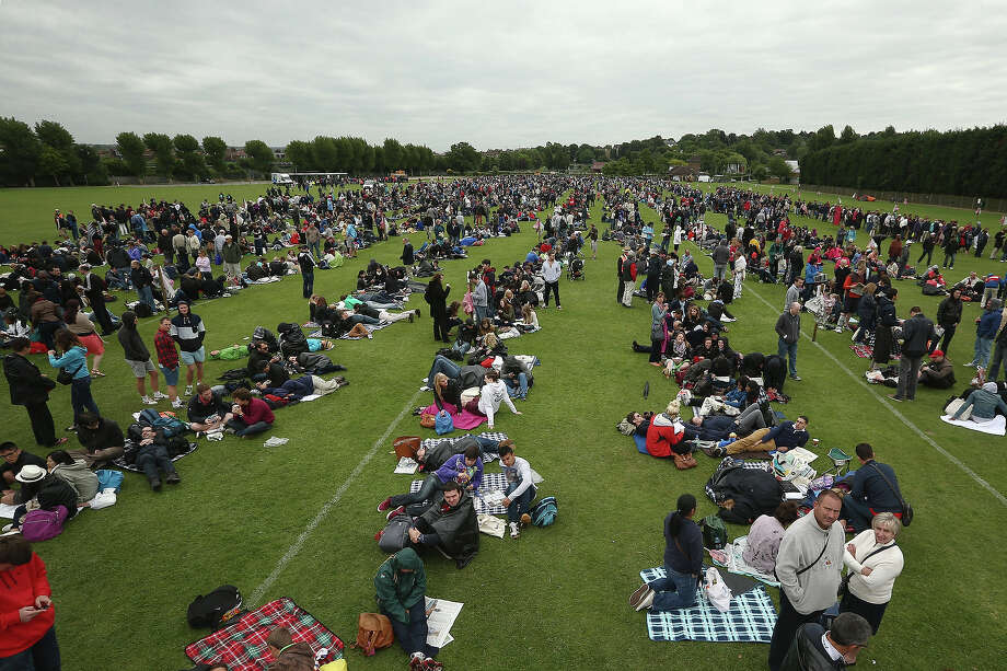 Fans queue for entry into the grounds on day one of the Wimbledon Lawn Tennis Championships at the All England Lawn Tennis and Croquet Club on June 24, 2013 in London. Photo: Dan Kitwood, Getty Images / 2013 Getty Images