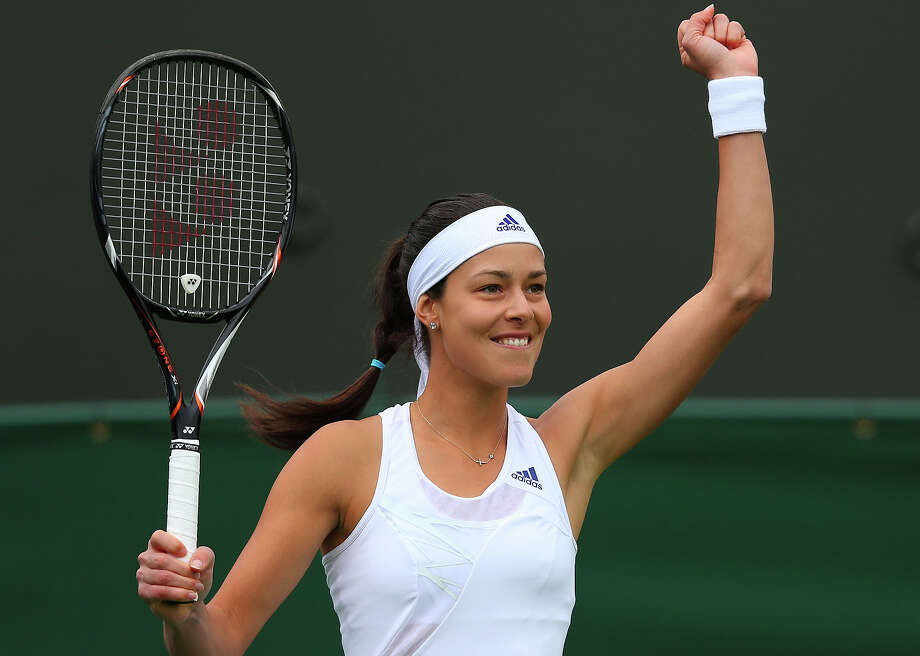 Ana Ivanovic of Serbia celebrates a point during her Women's Singles match against Virginie Razzano of France on day one of the Wimbledon Lawn Tennis Championships at the All England Lawn Tennis and Croquet Club on June 24, 2013 in London. Photo: Julian Finney, Getty Images / 2013 Getty Images
