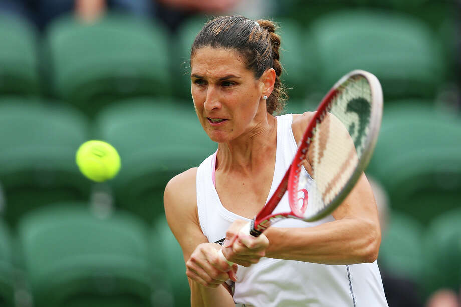 Virginie Razzano of France plays a backhand during her Women's Singles match against Ana Ivanovic of Serbia on day one of the Wimbledon Lawn Tennis Championships at the All England Lawn Tennis and Croquet Club on June 24, 2013 in London. Photo: Julian Finney, Getty Images / 2013 Getty Images