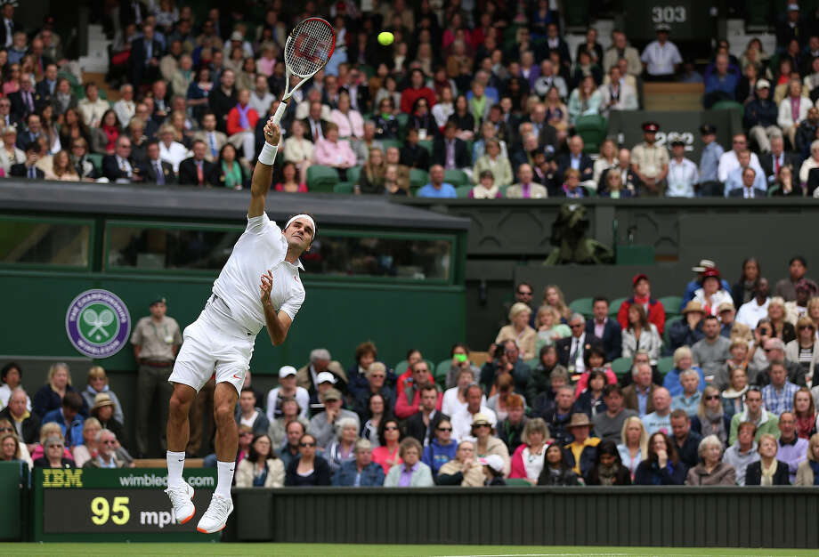 Roger Federer of Switzerland serves in his gentlemen's singles first round match against Victor Hanescu of Romania on day one of the Wimbledon Lawn Tennis Championships at the All England Lawn Tennis and Croquet Club on June 24, 2013 in London. Photo: Clive Brunskill, Getty Images / 2013 Getty Images