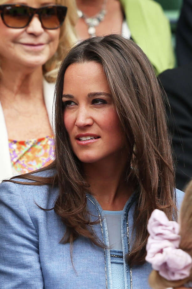 Pippa Middleton watches the gentlemen's singles match between Victor Hanescu of Romania and Roger Federer of Switzerland on day one of the Wimbledon Lawn Tennis Championships at the All England Lawn Tennis and Croquet Club on June 24, 2013 in London. Photo: Clive Brunskill, Getty Images / 2013 Getty Images