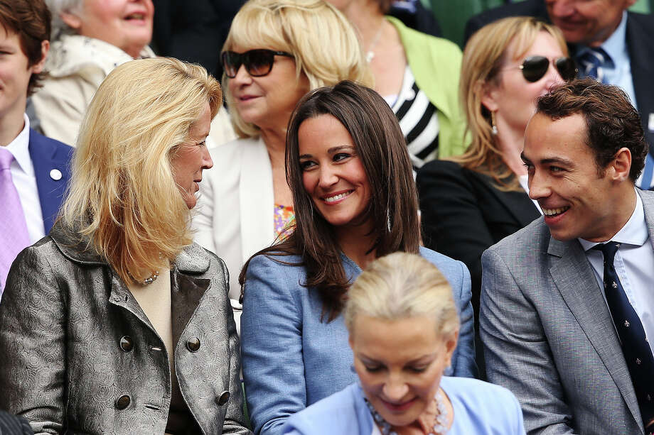 Pippa Middleton (C), Mariann Byerwalter (L) and James Middleton talk during the gentlemen's singles match between Victor Hanescu of Romania and Roger Federer of Switzerland on day one of the Wimbledon Lawn Tennis Championships at the All England Lawn Tennis and Croquet Club on June 24, 2013 in London. Photo: Clive Brunskill, Getty Images / 2013 Getty Images