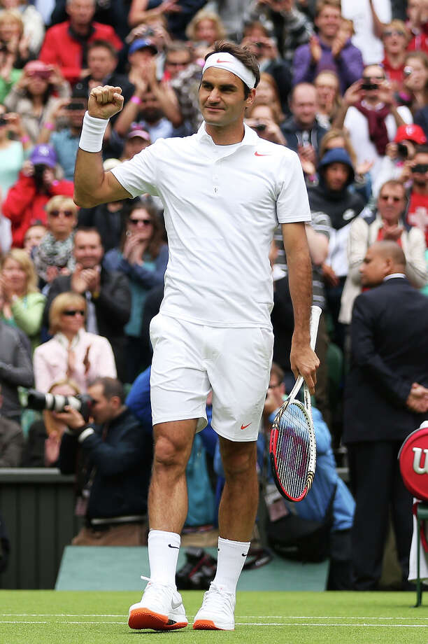 Roger Federer of Switzerland celebrates match point during his gentlemen's singles first round match against Victor Hanescu of Romania on day one of the Wimbledon Lawn Tennis Championships at the All England Lawn Tennis and Croquet Club on June 24, 2013 in London. Photo: Clive Brunskill, Getty Images / 2013 Getty Images
