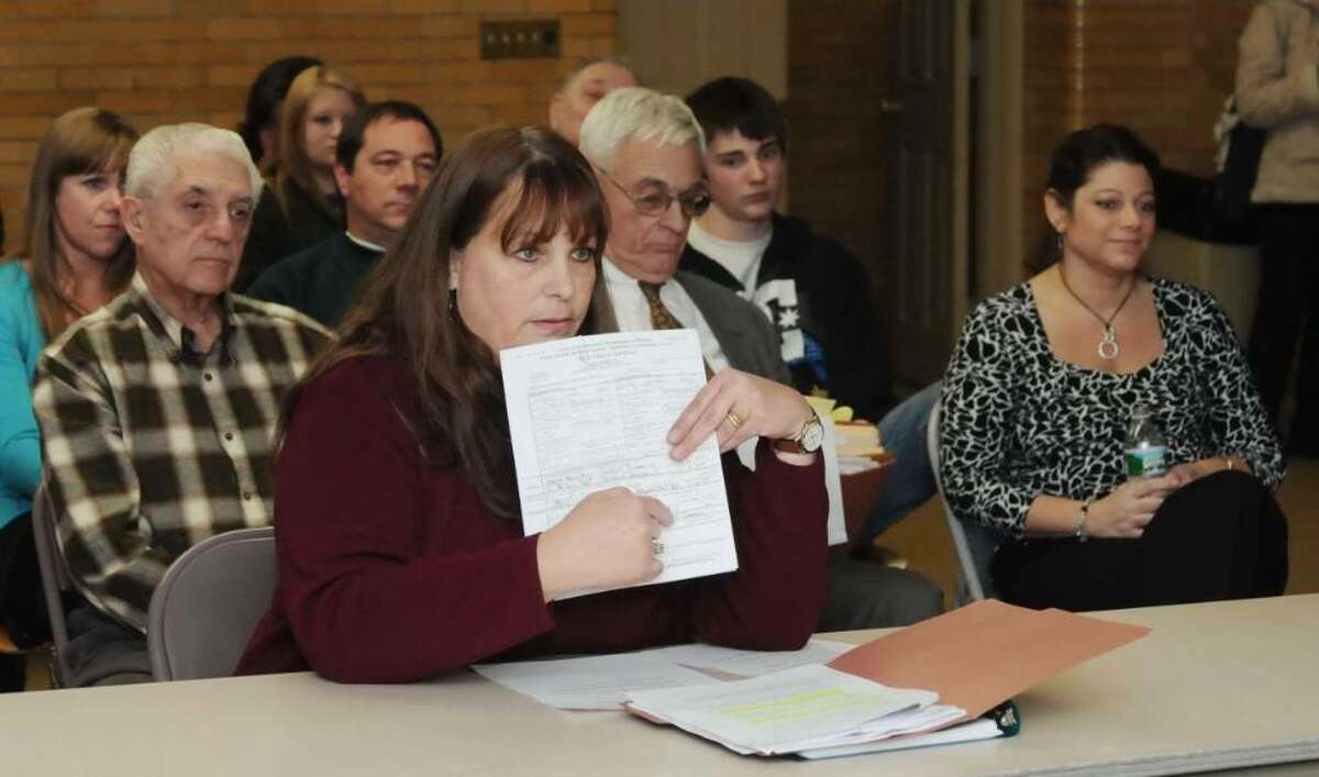 In Newtown a special Ethics Committee hearing was held on Thursday Jan. 14, 2010 on alleged offenses committed by Newtown Town Clerk Debbie Aurelia. Diane Guilfoil of Sandy Hook gives her testimony at the hearing showing the committee her stepson and step daughter-in-laws marriage license that had been issued by the Newtown Town Clerk office.