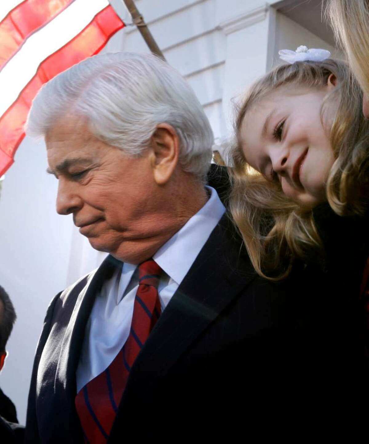 Christina Dodd rests her head on the shoulders of her dad, U.S. Sen. Christopher Dodd, D-CT, after he announced that he will retire after his current term outside his home in East Haddam, Conn., Wednesday Jan. 6, 2010. Dodd, who served five terms, is chairman of the Senate Banking Committee and made an unsuccessful bid for the presidency in 2008. (AP Photo/Charles Krupa)